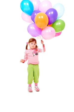 Image of small girl with helium balloons at party photo
