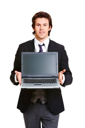 Portrait of elegant businessman showing laptop and looking at camera photo