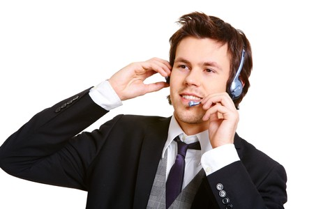 Young businessman in headset consulting client at work photo