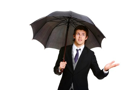 Image of elegant businessman under black umbrella photo