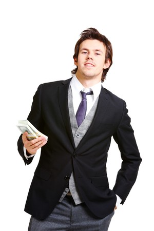 man holding money: Portrait of successful businessman in elegant suit holding dollars