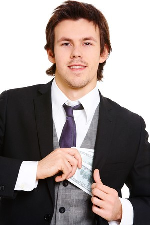 Portrait of successful businessman in elegant suit taking out dollars photo
