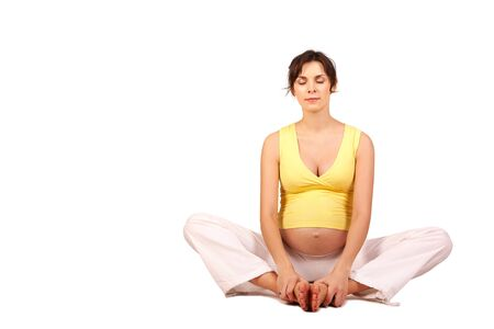 Portrait of pretty pregnant woman meditating over white background Stock Photo - 7020559