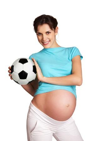 pretty pregnant woman holding ball on white background photo