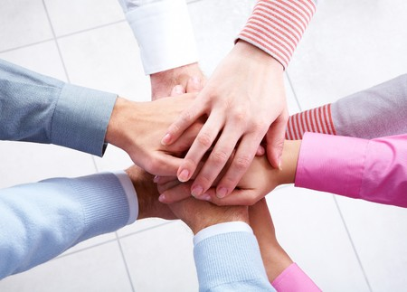 fingers on top: Close-up of business people's hands on top of each other  Stock Photo
