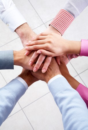 altogether: Close-up of business people�s hands on top of each other