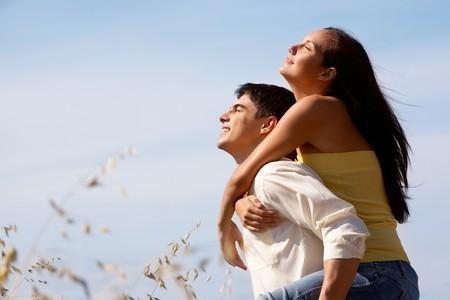 Portrait of girlfriend and boyfriend enjoying summer day outdoors  photo