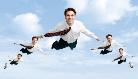 flying man: Conceptual image of many businessmen flying in the clouds
