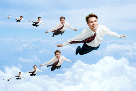 Conceptual image of many businessmen flying in the clouds Stock Photo - 7032972