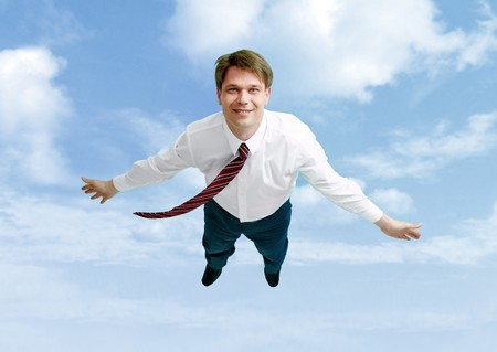 high: Conceptual image of happy businessman flying in the clouds Stock Photo