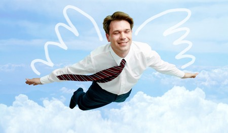 Conceptual image of smiling businessman with wings flying in the clouds Stock Photo - 7032975