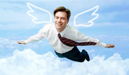 man flying: Conceptual image of contented businessman with wings flying in the clouds