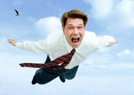 Conceptual image of young businessman shouting while flying in the clouds Stock Photo - 7032980