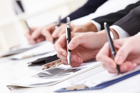 Close-up of business person hand working with document Stock Photo - 7059795