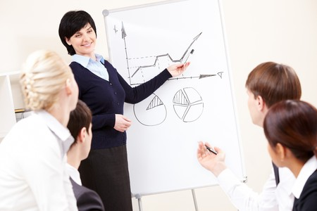 Image of confident woman making presentation and interacting with the audience Stock Photo - 7059784