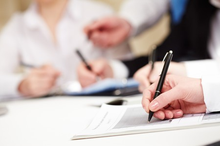 Close-up of business person hand with pen over document Stock Photo - 7059789