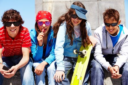 Row of several teens in sunglasses looking at camera Stock Photo - 7059852