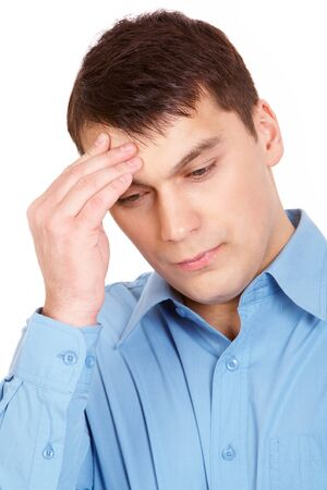 loss leader: Portrait of young man touching his forehead with tired expression