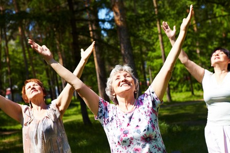 Portrait of aged women with their arms raised in praise Stock Photo - 7059925