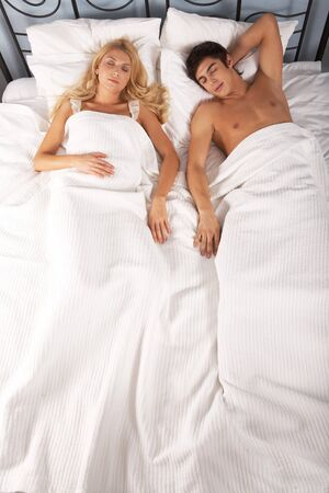 Photo of attractive woman and man sleeping in bed photo