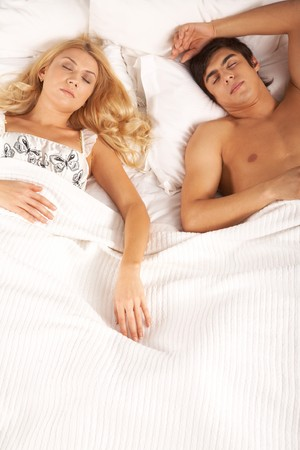 Photo of serene woman and man lying in bed and sleeping photo