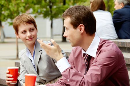 coffee meeting: Portrait of happy business partners having break outside at summer Stock Photo