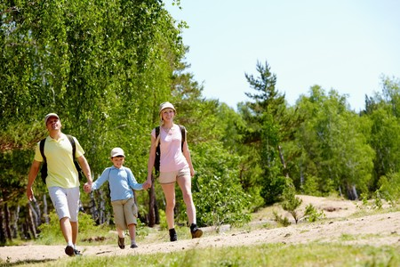 Portrait of happy family walking down countryside at summer Stock Photo - 7088734