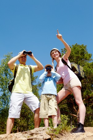 Portrait of family members looking far in country at summer photo