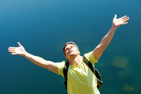 Image of man with stretched arms on background of water outdoors Stock Photo - 7088750