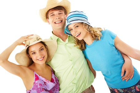 Portrait of happy man and girls in hats looking at camera in isolation Stock Photo - 7096001