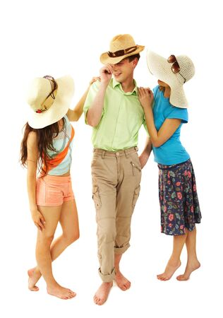 Portrait of stylish man and girls in hats chatting photo