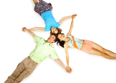 Above view of three friends holding by hands in isolation Stock Photo - 7095979