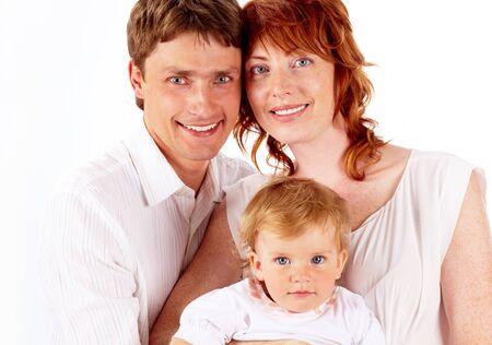 Portrait of joyful family looking at camera over white background photo
