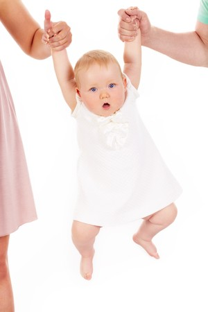 Portrait of small girl being held by her parents Stock Photo - 7125908