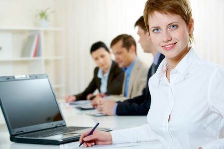 Image of pretty blue-eyed female looking at camera in working environment Stock Photo - 7125900