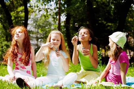Portrait of cute girls having fun on green lawn in park Stock Photo - 7126048
