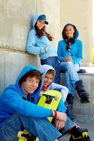 Portrait of several teens looking at camera while spending time outdoors Stock Photo - 7147928