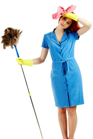 duster: Portrait of nice housewife wearing blue robe with brush and duster in hands Stock Photo