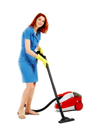 Portrait of nice housewife doing housework with vacuum cleaner photo