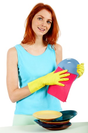 Portrait of young female holding plate and washing it photo
