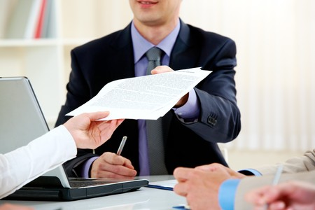 handing over: Close-up of handing over documents during business briefing