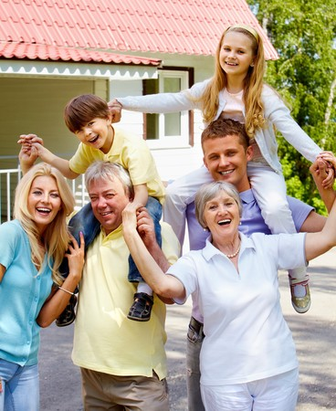 Portrait of senior and young couples with children outdoors by their cottage Stock Photo - 7180217