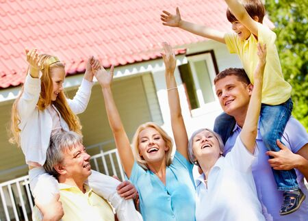 Portrait of happy senior and young couples with children outdoors by their cottage Stock Photo - 7180219