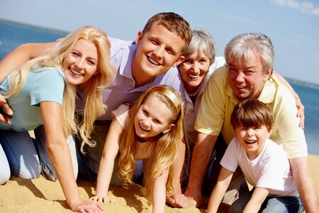 Portrait of big happy family looking at camera during vacation photo