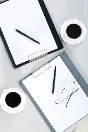 Image of blank paper sheet with fountain pen, eyeglasses and cup of coffee near by photo