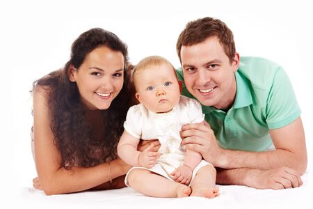 Portrait of joyful family looking at camera over white background photo