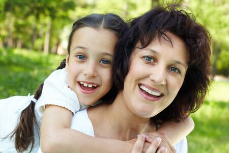 Portrait of mother and daughter having fun on summer day photo
