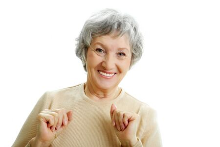 grey haired: Portrait of happy grey haired woman looking at camera