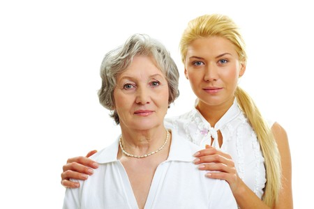 kin: Portrait of attractive woman touching her old mother   Stock Photo