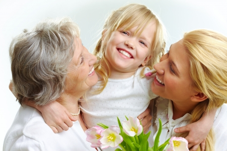 grandmother grandchild: Portrait of happy girl hugging mature lady and woman